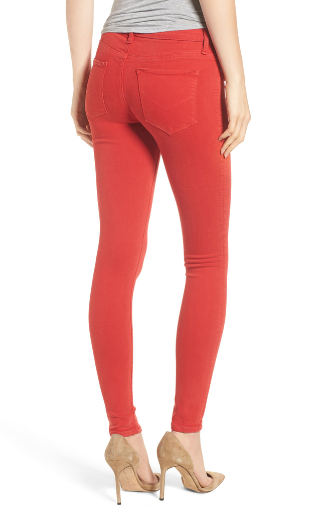 Yieldings Discount Clothing Store's Nico Mid-Rise Skinny Jeans by Hudson in Distressed Rocco Red