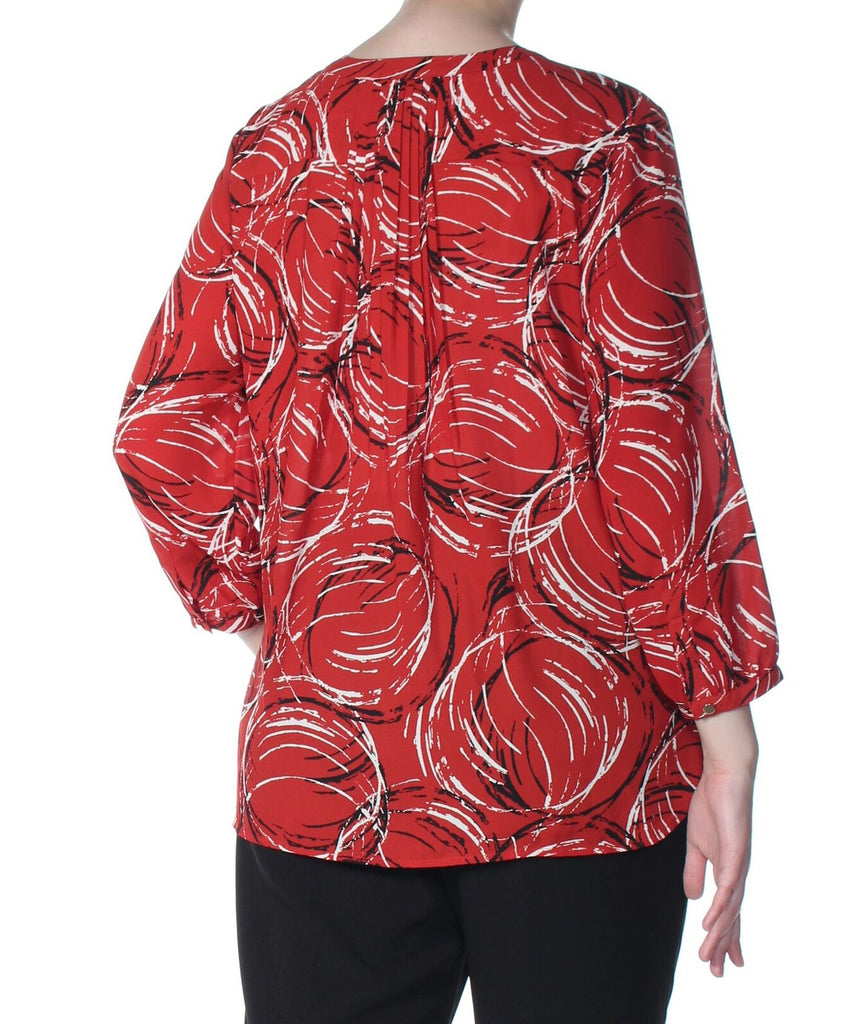 Yieldings Discount Clothing Store's Printed Pleated-Back Blouse by JM Collection in Brushed Circles