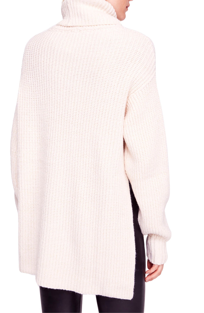 Yieldings Discount Clothing Store's Eleven Ribbed Knit Side Slit Turtleneck Sweater by Free People in Cream