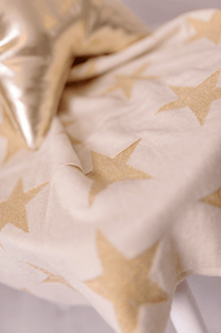 Dazzling gold star knitted baby blanket, the perfect glitzy blanket for out and about.