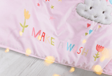 Pink cot bed quilt featuring a unicorn and rainbow, stunning appliques.