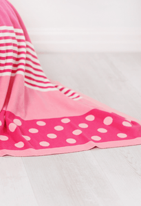 Pink baby blanket in a mix of patterns perfect for any little girl.