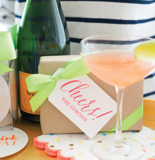 Cheers gift tags shown here in a peachy coral color. Perfect for gifts.