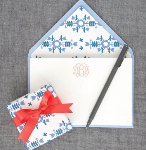 Beautiful letterpress stationery shown here with a pink monogram and beautiful lined blue envelopes.
