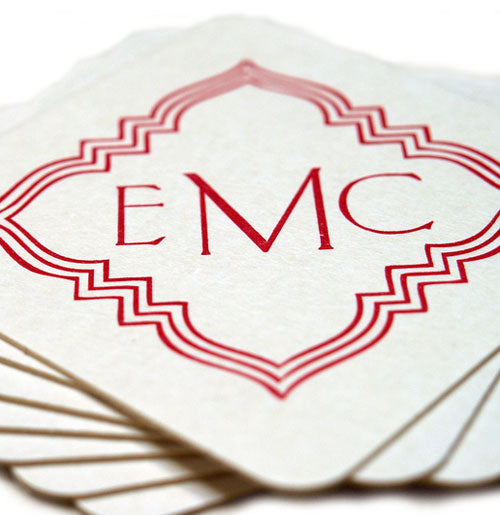 Custom coasters printed in cherry red.