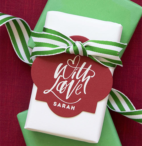 With love Christmas tags shown here with white ink on red paper.