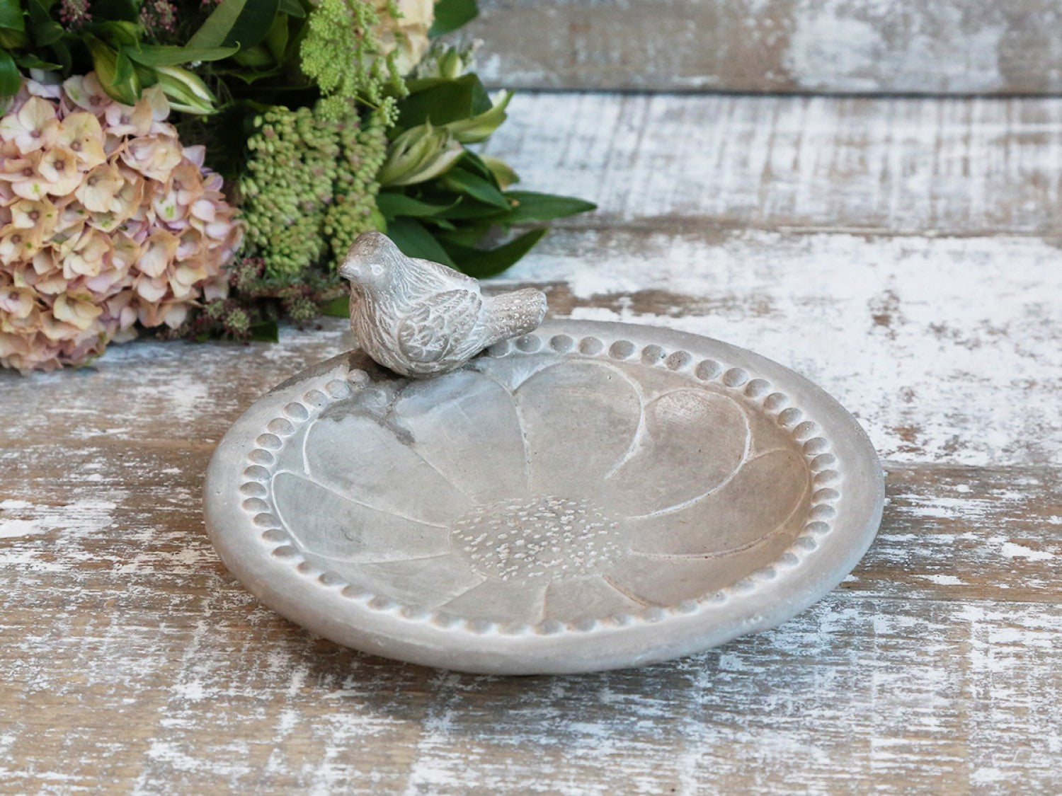 Cement birdbath with pearl edge