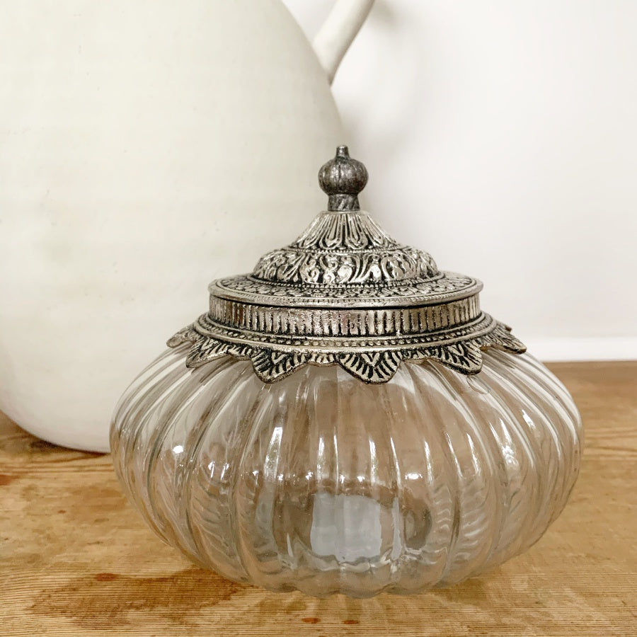 Embossed metal lidded jar