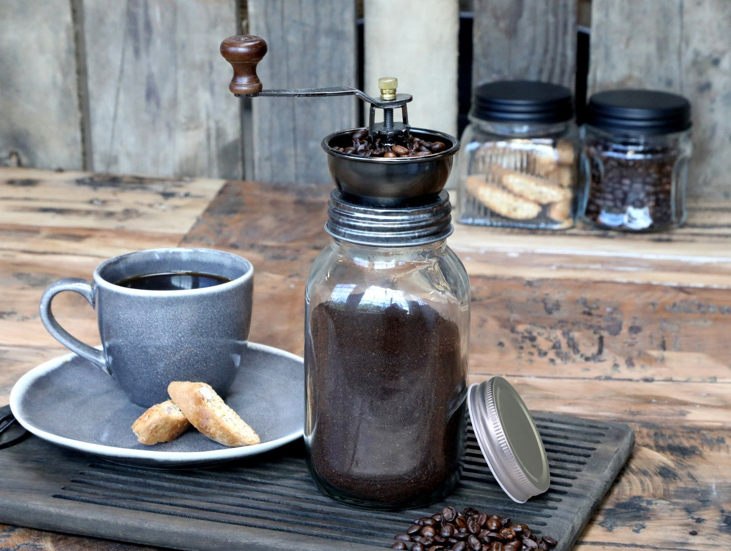 Coffee grinder with antiqued lid