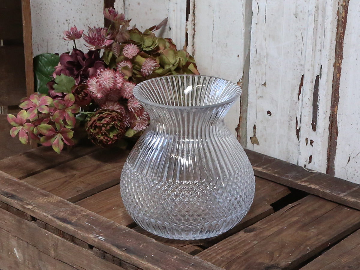 Glass vase with grooves and diamond cuttings