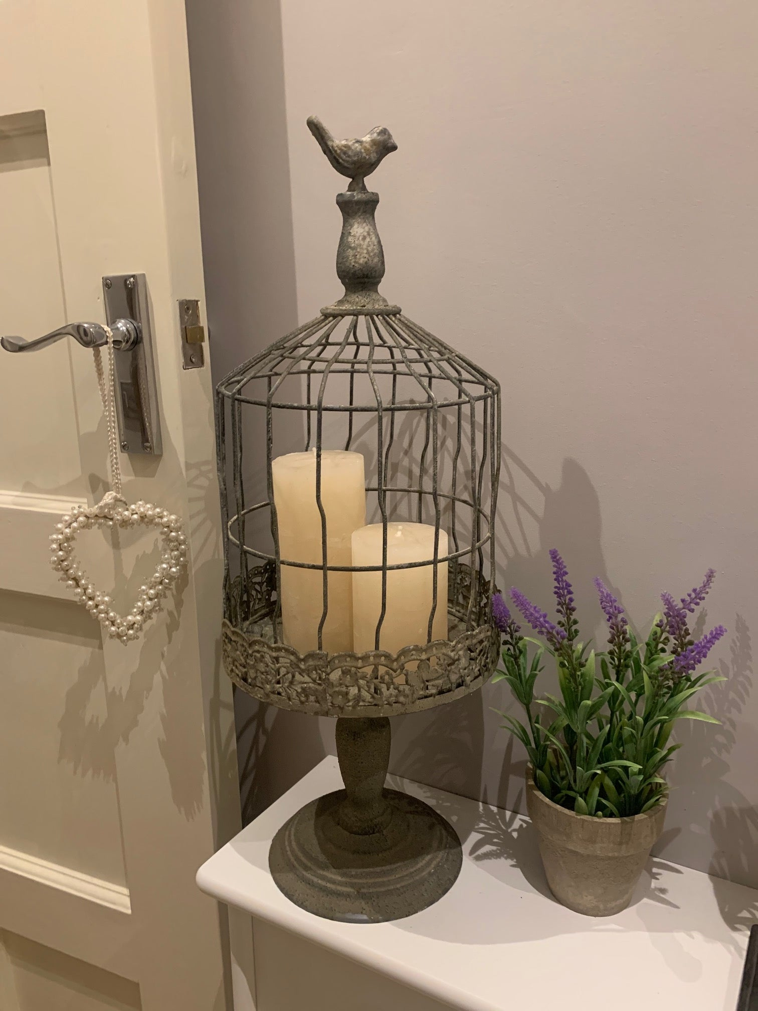 Distressed metal birdcage on stand
