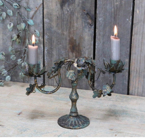 Antique brass candle holder with leaves