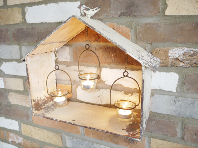 Rustic bird house with tealight holders