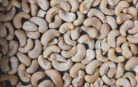 Aerial view of raw cashew nuts bought wholesale to make plant-based foods and ingredients