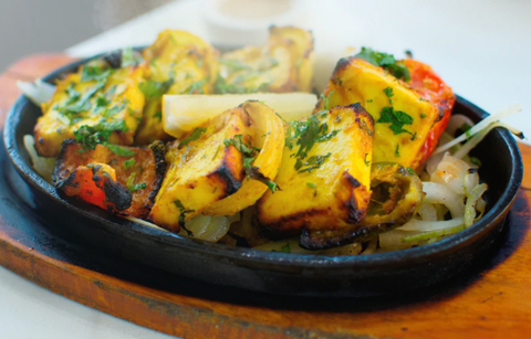 Spicy Tandoori paneer and grilled vegetables made from plant-based alternative to cottage cheese