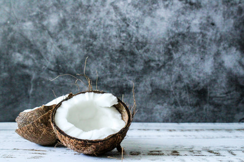 Cut open coconut used to make plant-based alternatives to cooking oil and milk