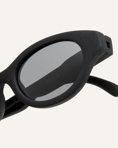 gray oval-shaped glasses