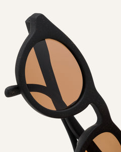 eco sunglasses with brown round lenses