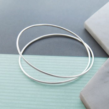Solid Silver Interwoven Spring Bangle