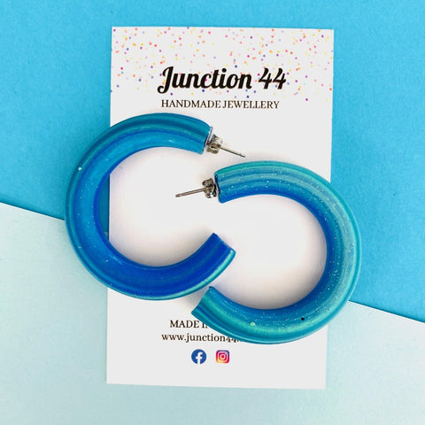 6cm C shaped blended blue polymer clay earrings. Junction 44.