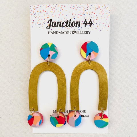Multi coloured studs with brass dangles attached. 6cm long. Junction 44.