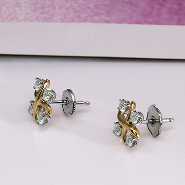 doveggs 0.6ct round moissanite stud earrings in white gold and yellow gold