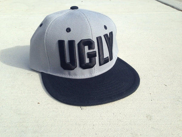 """UGLY"" grey snap back"