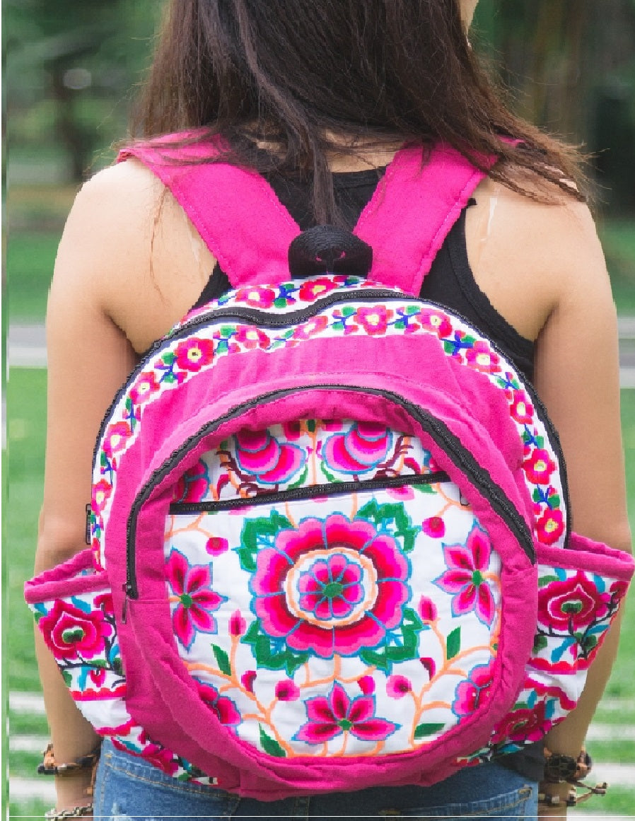 White and pink floral backpack