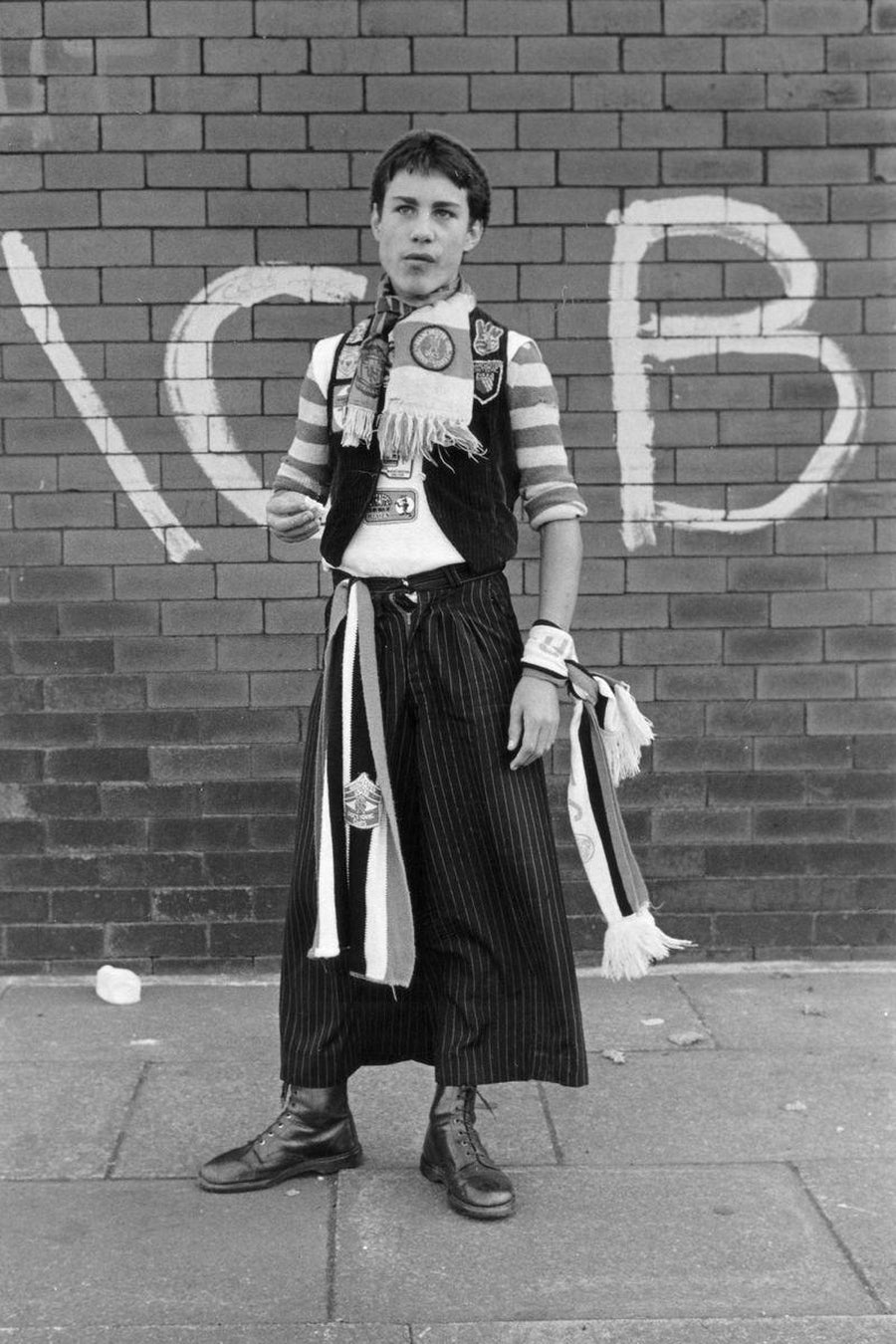 Skirt or Trousers? Stylish Manchester United Fan Dressed For the Match by Iain S. P. Reid, c. 1977