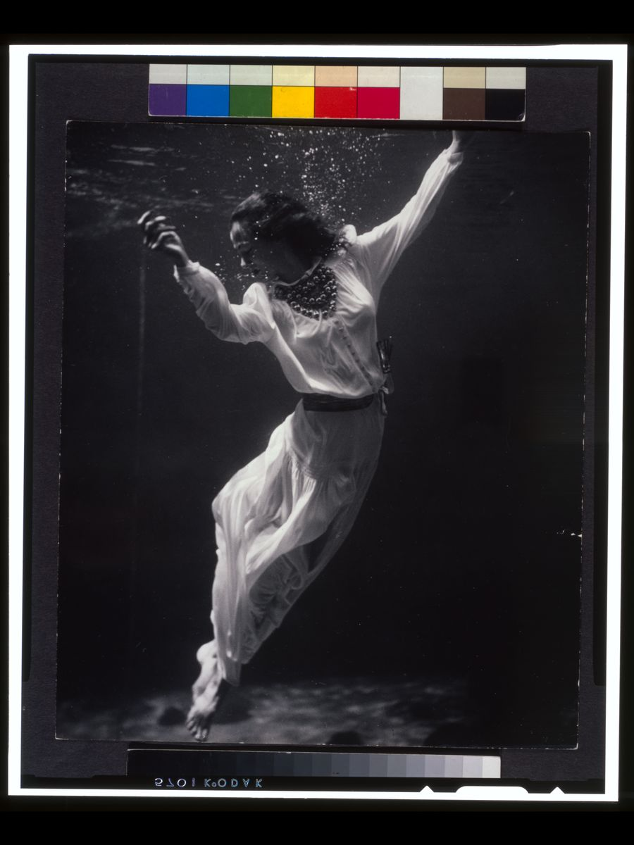 A fashion model underwater in the Dolphin Tank at Marineland, Florida by Toni Frissell - 1939.