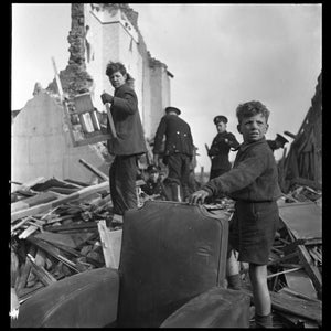 People and wreckage of buildings after a bombing raid of London during World War II in January 1945.