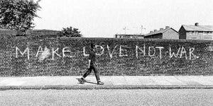 'Make Love Not War' Graffiti in East London by Steve Lewis.