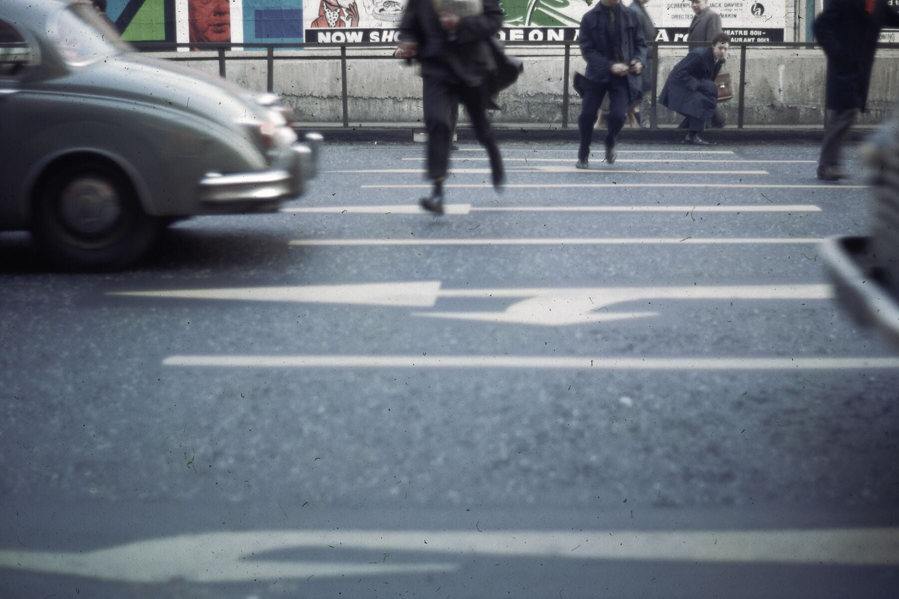 Running Across A London Street by Bob Hyde - 1960s