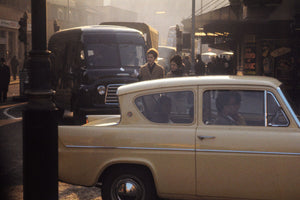 Cream Ford Anglia in London by Bob Hyde - 1960s