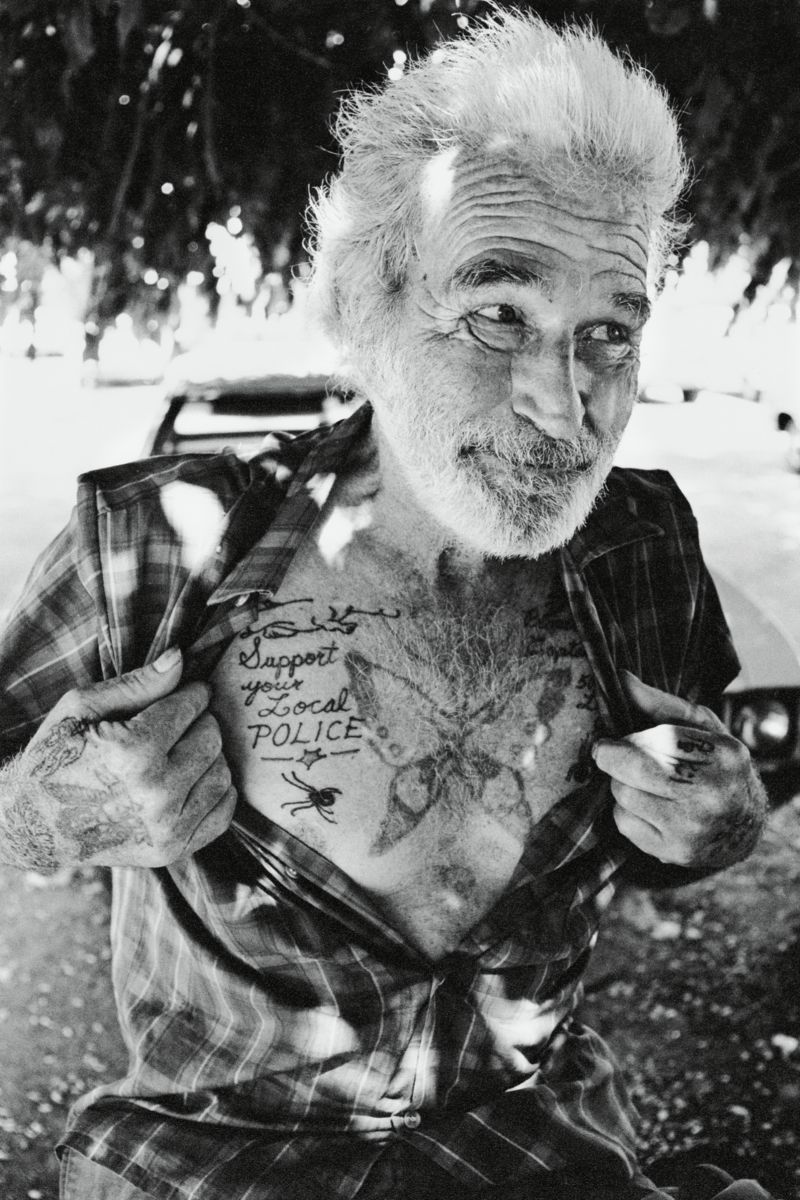 Man With Support Your Local Police Tattoo - Lummus Park, Miami by Michael Carlebach.