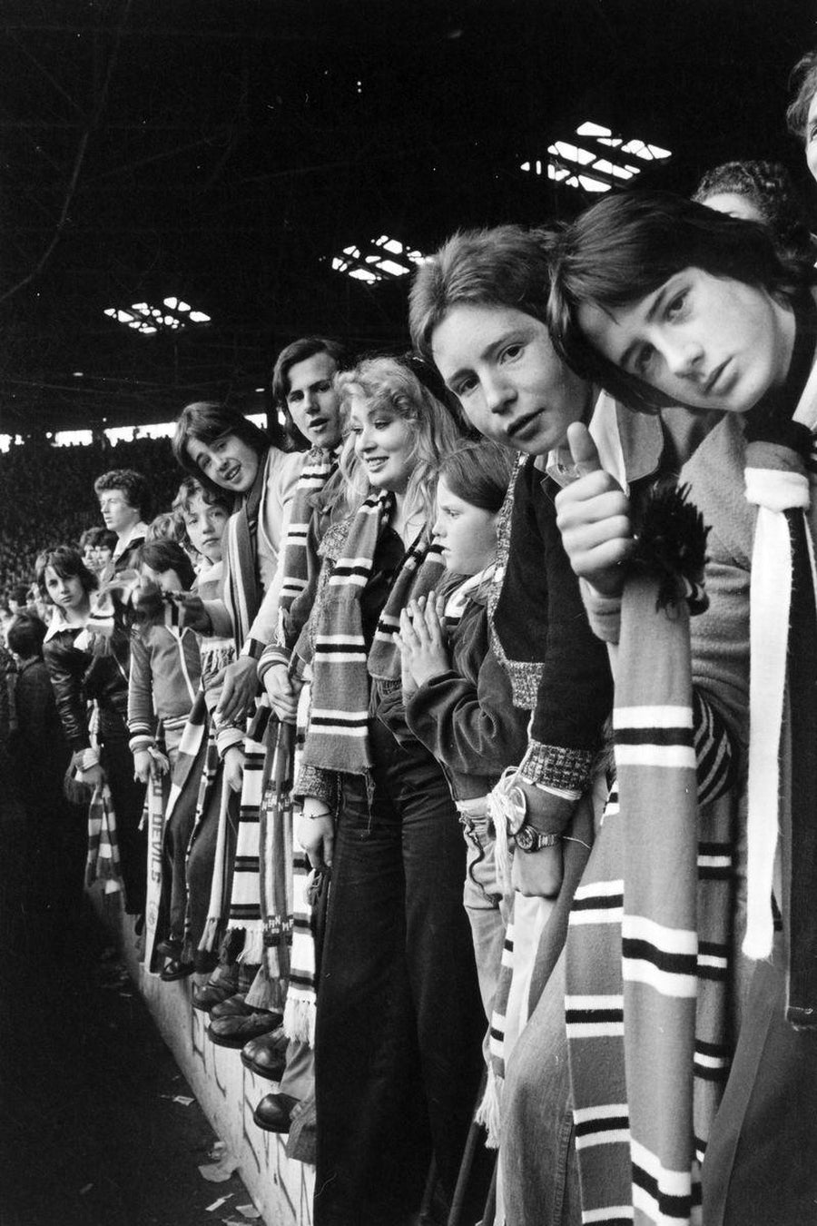 Manchester United Fans on the Terraces by Iain S. P. Reid, c. 1977