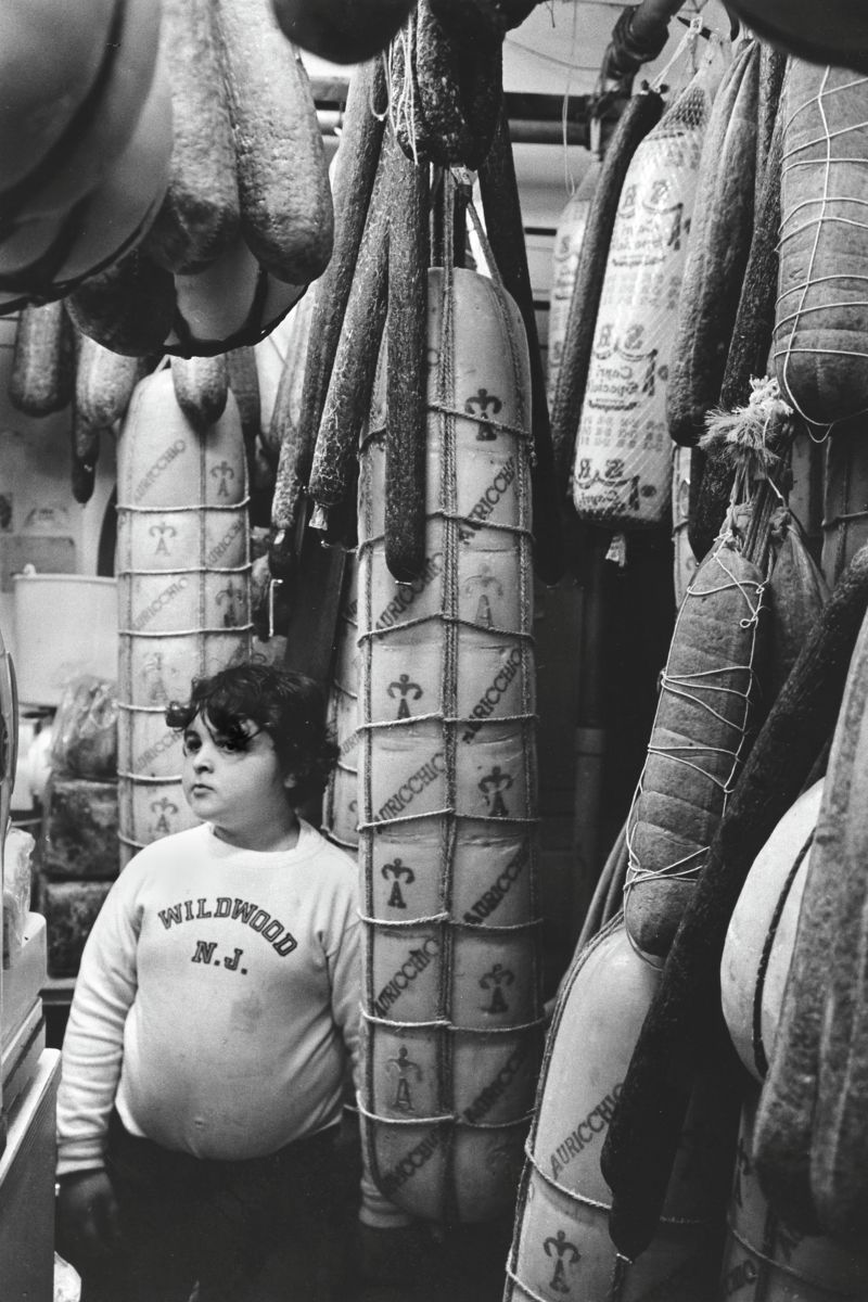 Boy in Italian Grocery Store, Philadelphia by Michael Carlebach - 1973