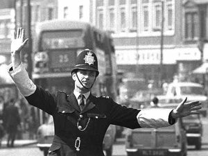 Policeman in East London by Steve Lewis - 1960s