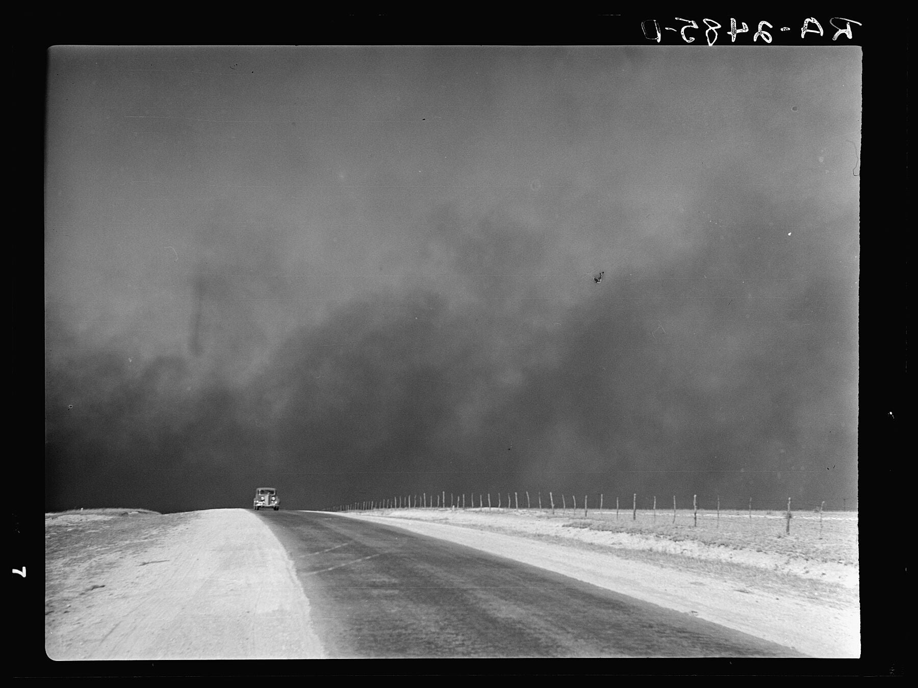 Heavy Black Clouds of Dust Rising over the Texas Panhandle, by Arthur Rothstein - 1936