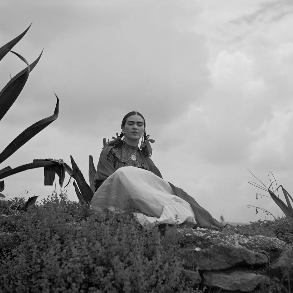 Frida Kahlo Seated Next to an Agave Plant by Toni Frissell - 1937