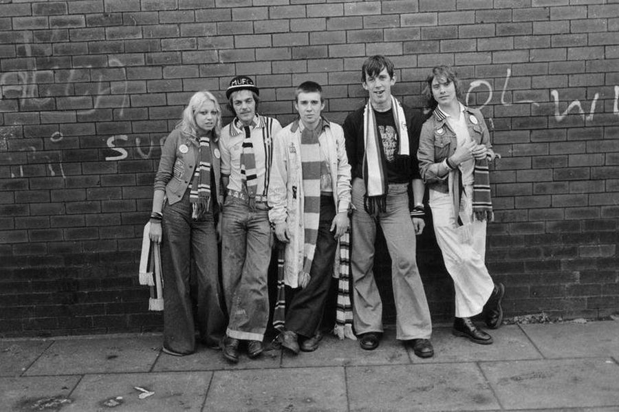 Group of Manchester United Fans Against a Brick Wall by Iain S. P. Reid, c. 1977