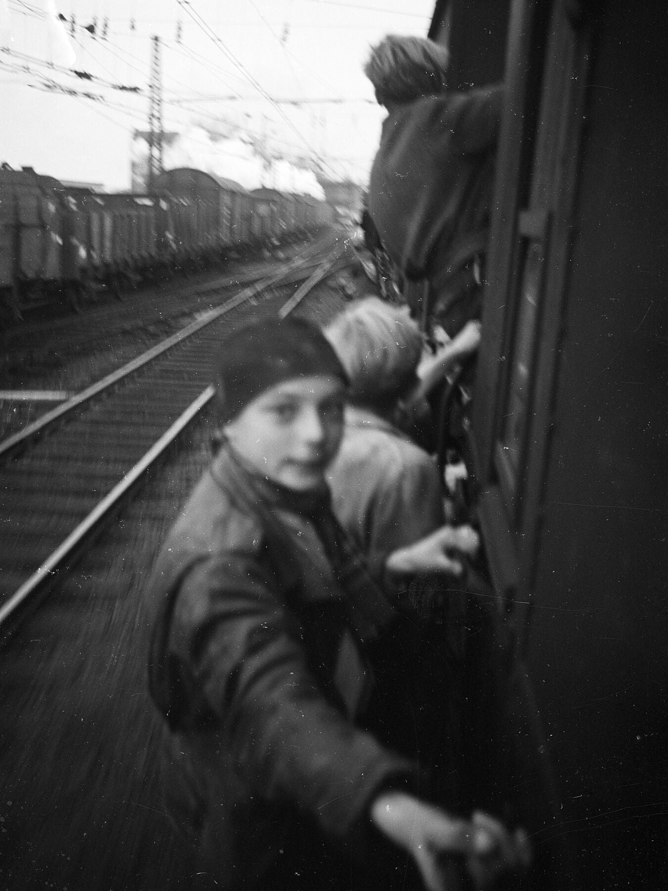 Boys Cling On to a Train as They Celebrate The Netherlands' Freedom from German Occupation (IV) - by Menno Huizinga - 1945
