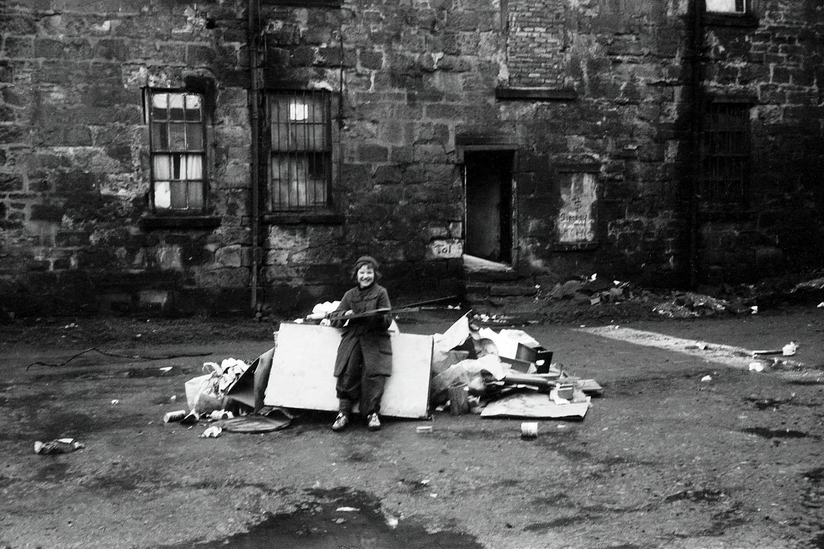 Children playing at a Glasgow tenement in 1975 by John J Brady.
