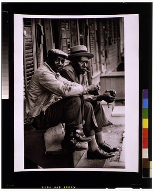 Two men sitting on stoop, Charleston, South Carolina by Toni Frissell - 1962