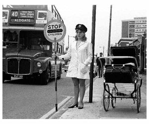 Leslie Lucking combined the roles of Lollipop lady and mother to her daughter Tracey - Forest Gate, London c.1967 by Steve Lewis.