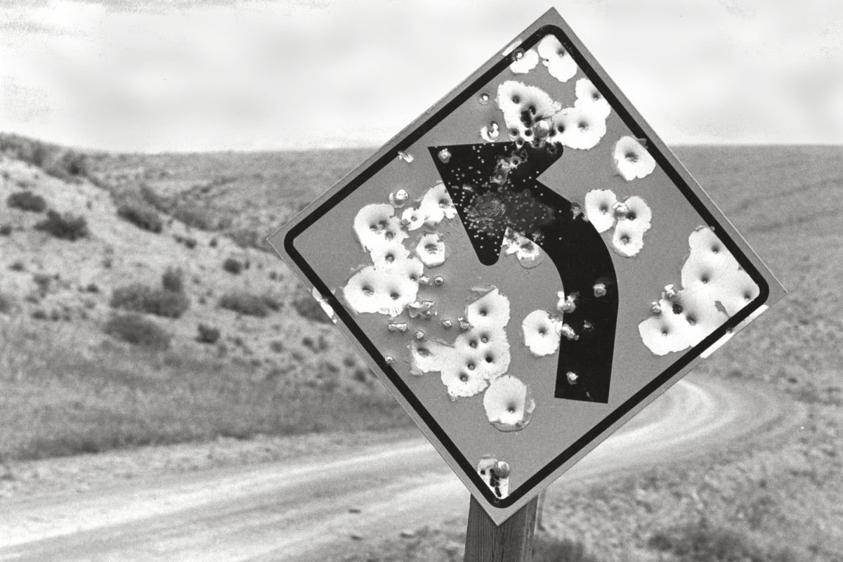 Sign with Bullet Holes, Wyoming by Michael Carlebach - 1992-06-29