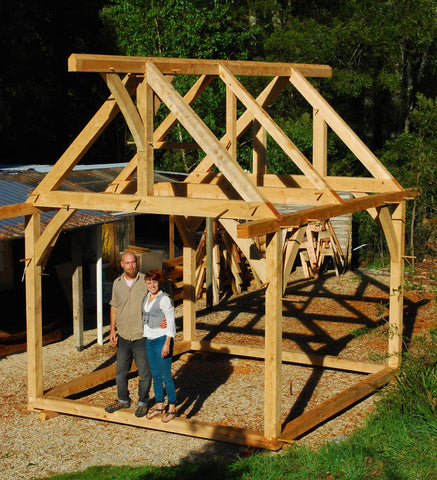 Liv and Graeme Scott standing in one of their timber frames