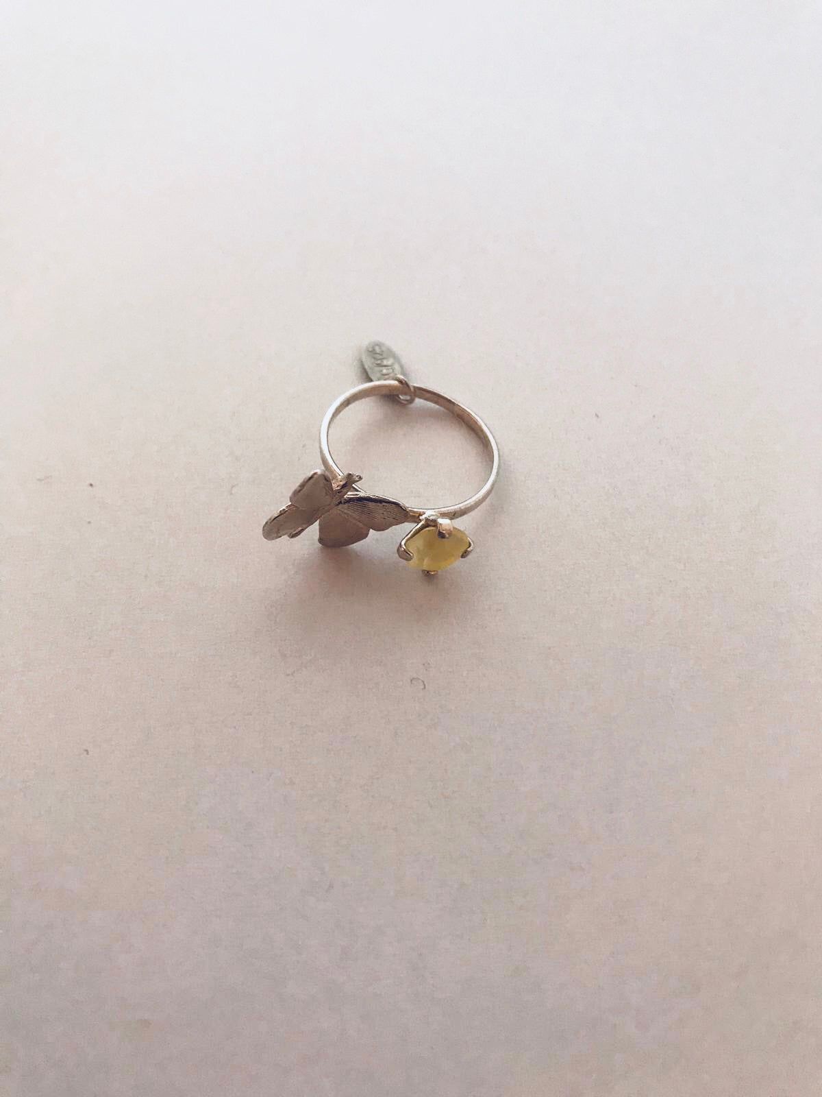 Wouters & Hendrix - silver butterfly ring with yellow crystal