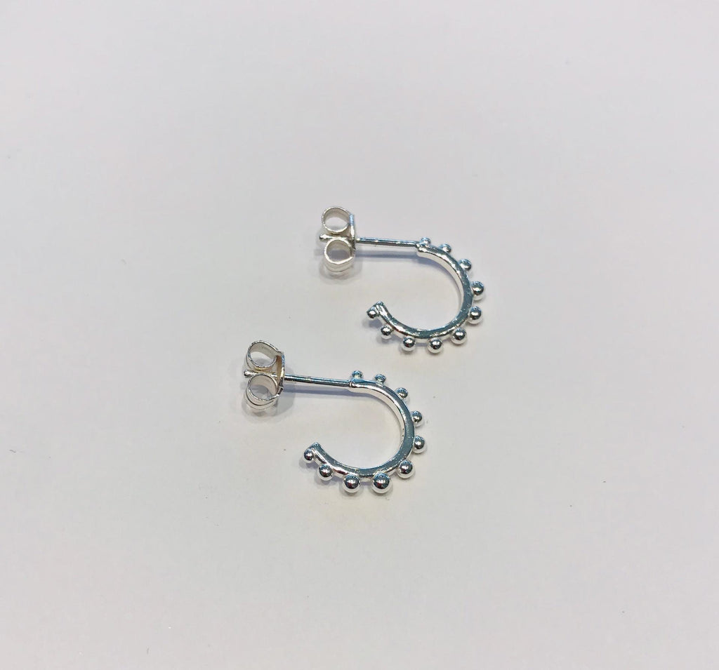 Small silver creole earrings by SAM&CEL.