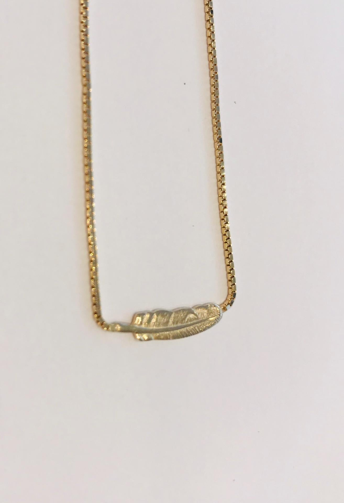 Fine gold plated necklace with beautifully cafted feather